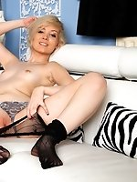 UK blonde in patterned fishnet pantyhose rubbing her puffy pussy