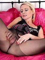 Horny milf stretches and rips open her dark control top pantyhose